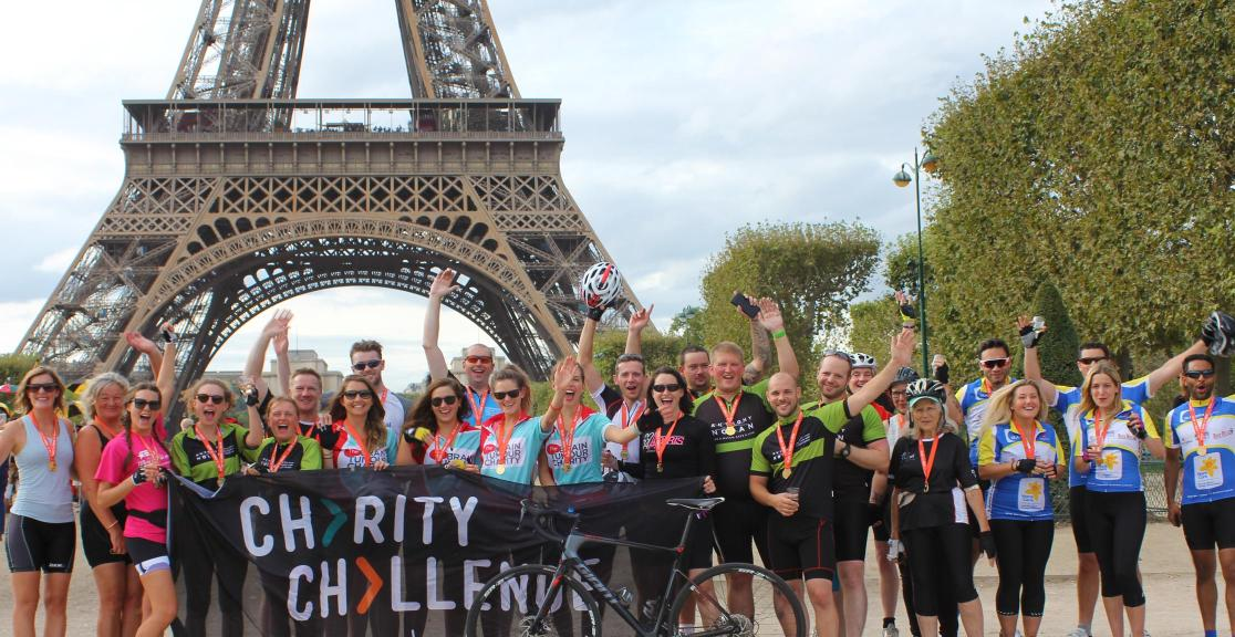 London to Paris cycle group at Eiffel Tower