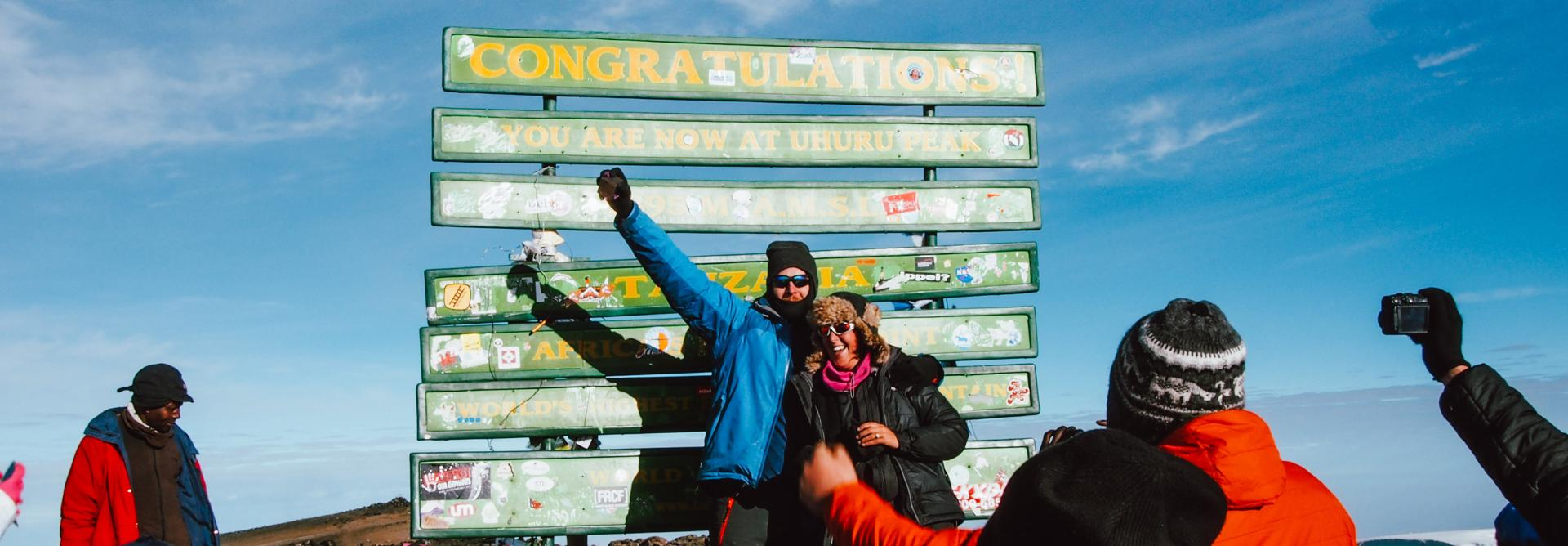 Celebrating a successful summit of Mt. Kilimanjaro with Charity Challenge
