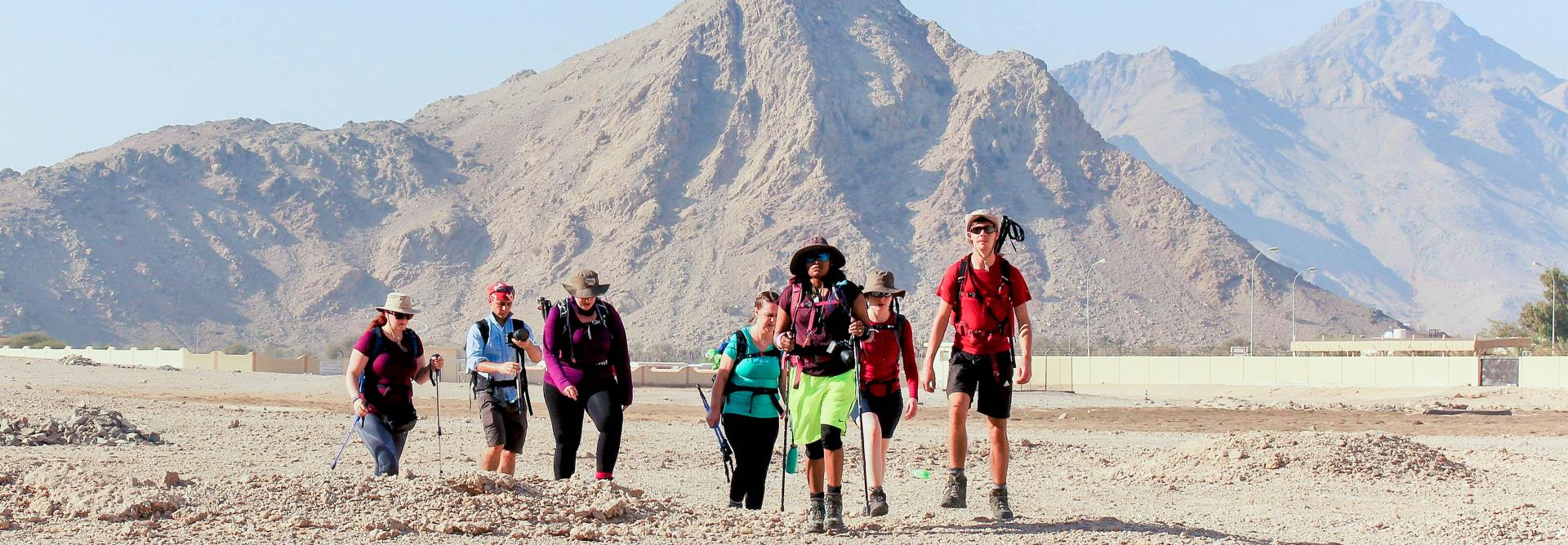 hikers walk the pathways of the Oman Mountain Trek