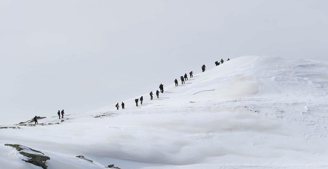 Balkans Winter Challenge hikers on summit
