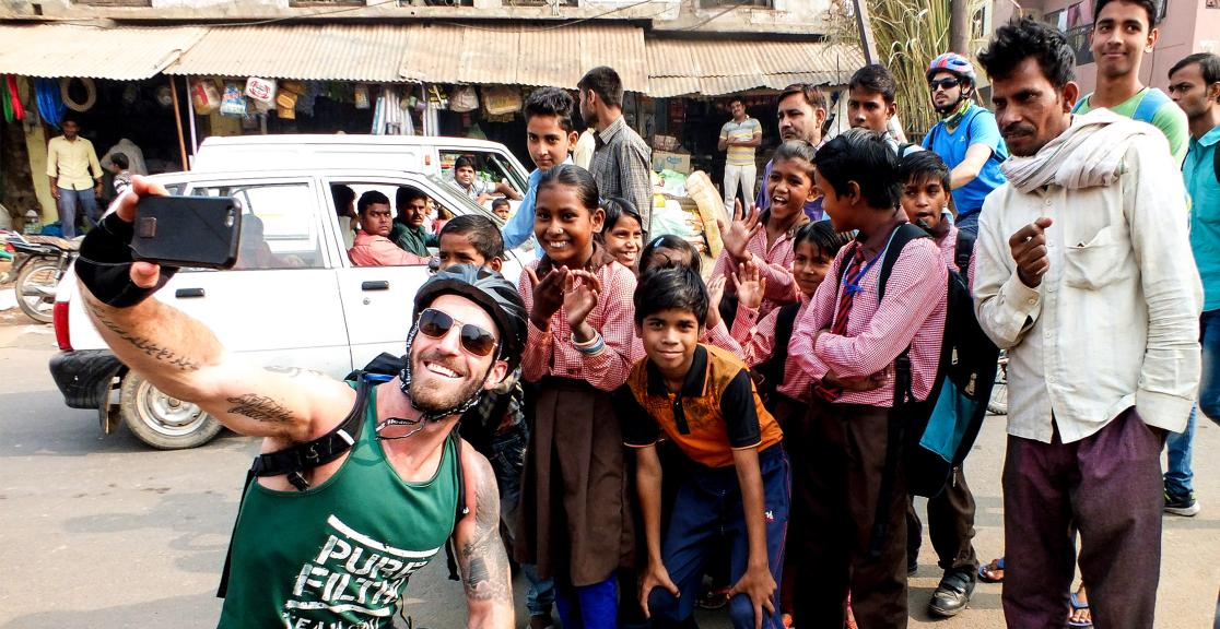 Selfie with locals in India while on the cycle challenge