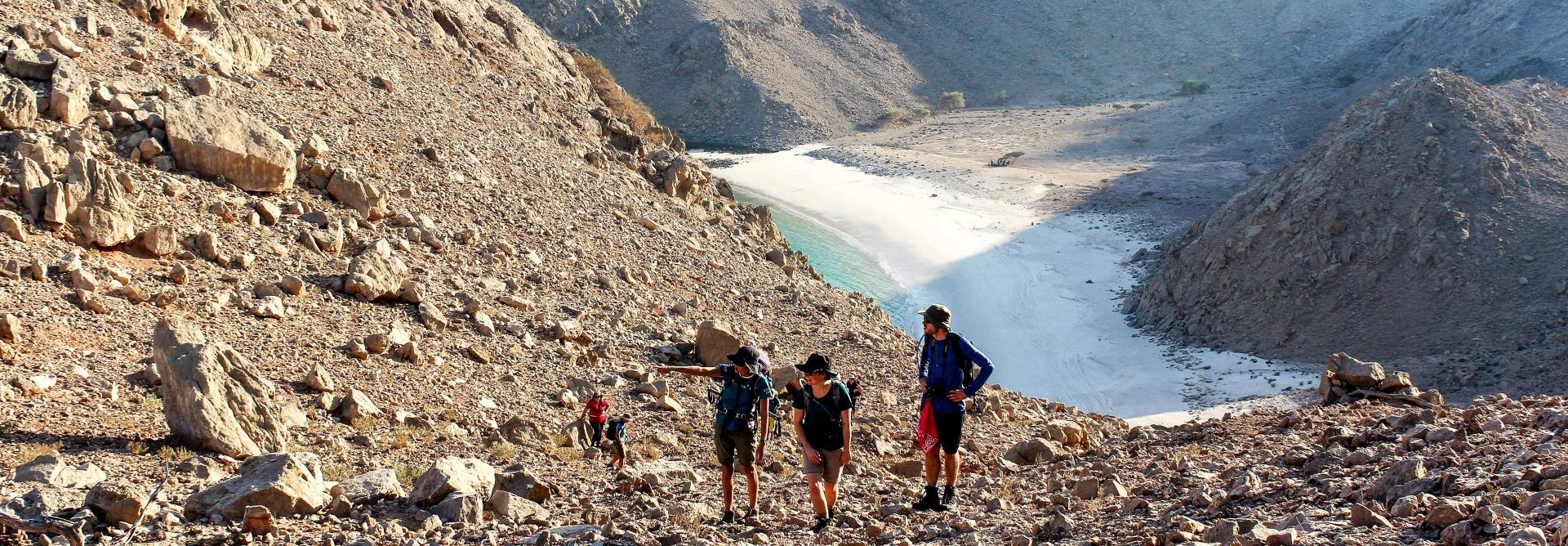 Hiking up dry mountains on the Oman mountain trek