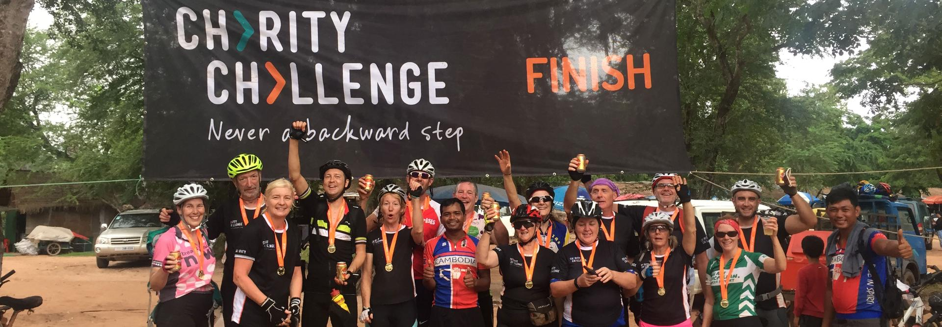 A group of Charity Challenge participants celebrate completing the Saigon to Angkor Wat cycle