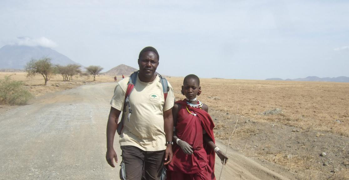 Sam our local trekking tour leader with young Maasai